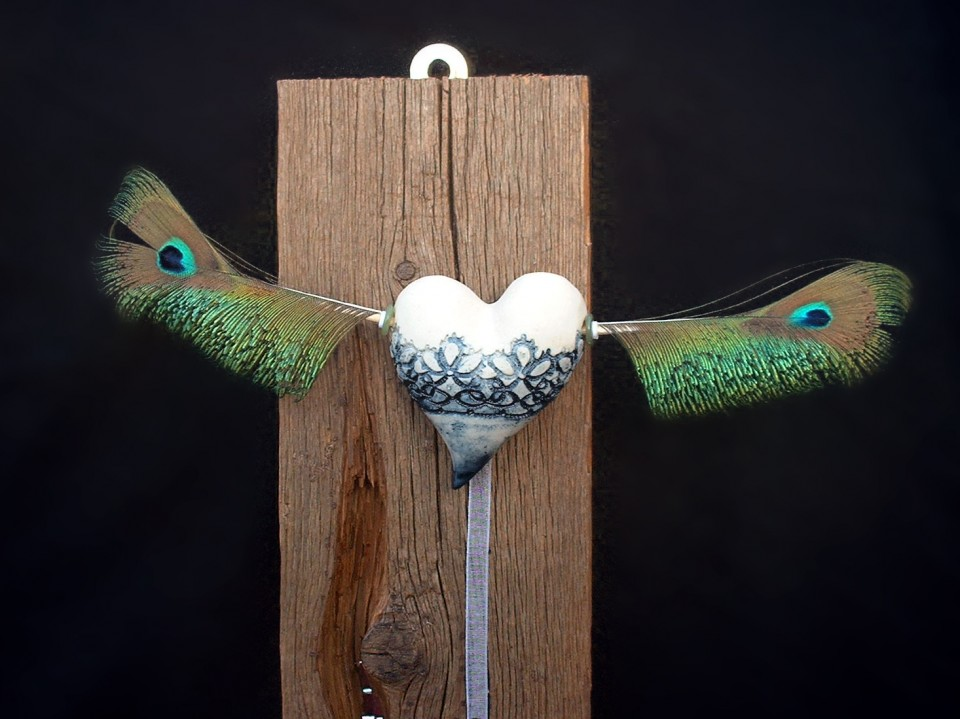 Flying heart peacock detail