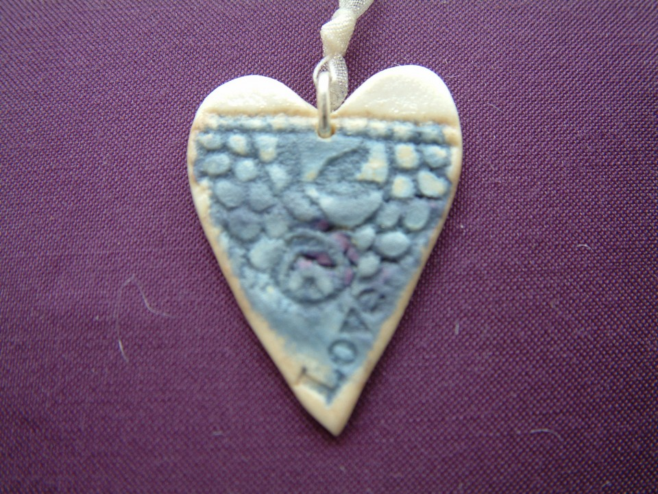 Heart pendant blue closeup