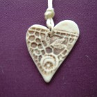 Heart pendant imprint detail