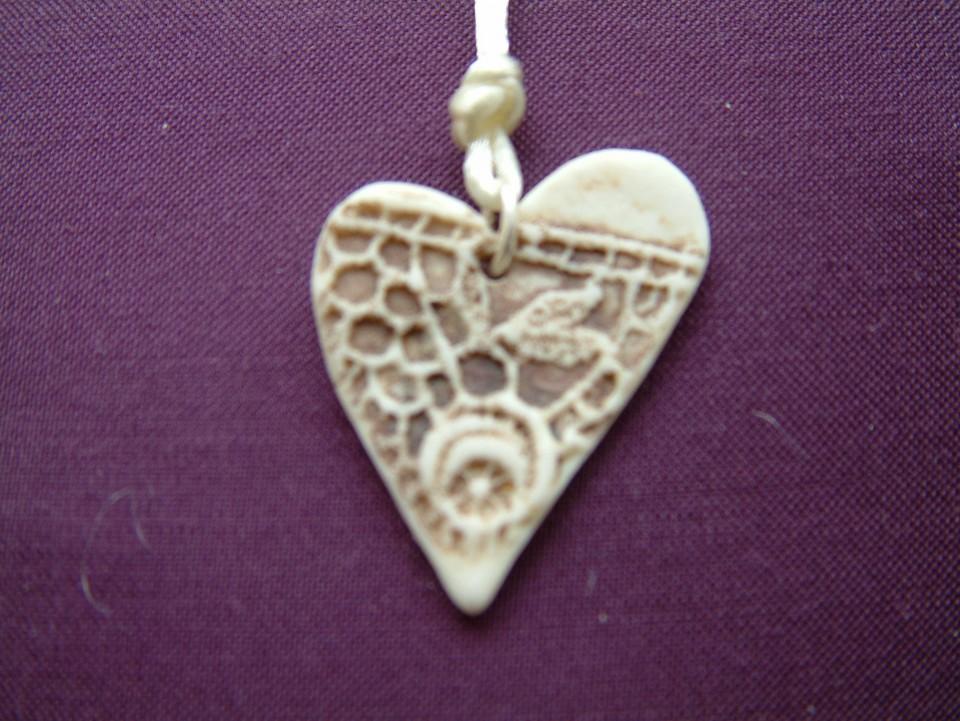 Heart pendant imprint detail