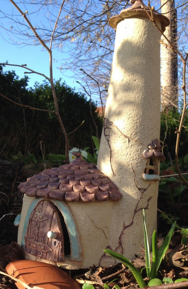 Round fairy house with a turret