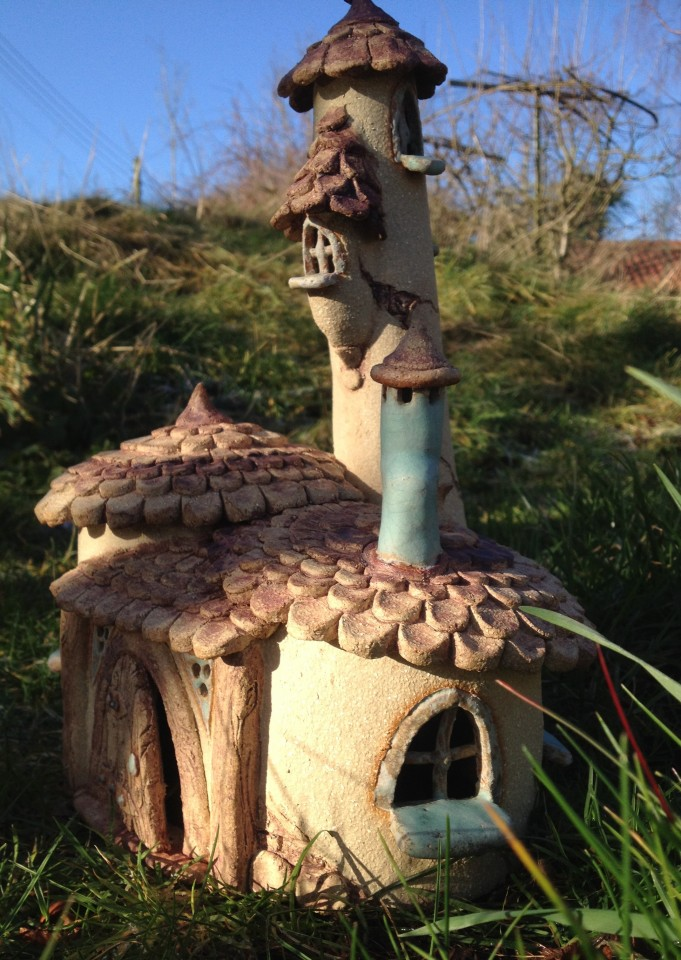 Big fairy house with turret and chimney